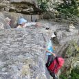 packs off for the tight squeezes on Caveman's Overhang route